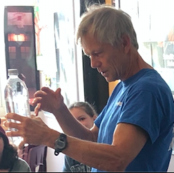 Mr. Holman is teaching students about Occom's Razor. This experiment is named after Rene Descartes (1596-1650), a French scientist and mathematician who used the diver to demonstrate gas laws and buoyancy. Occam's Razor is a scientific principle that suggests we explain evidence using theories that require the fewest new assumptions to be made.  That means that the simplest answer is most likely the correct one!