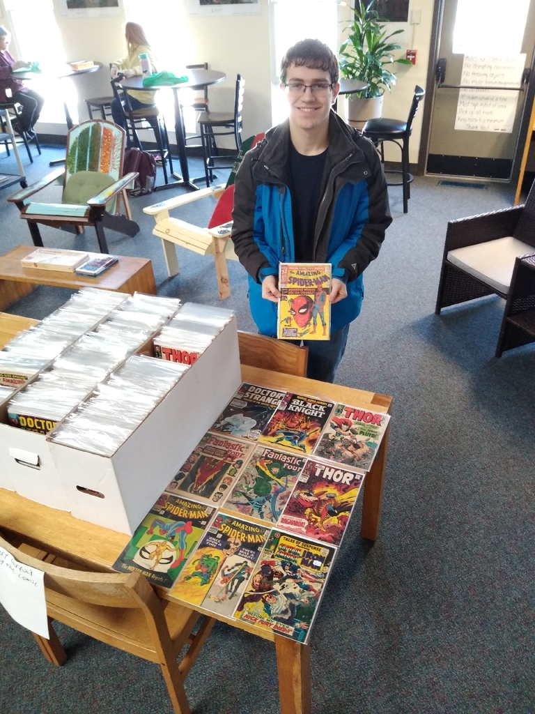 Danny displays early comic books
